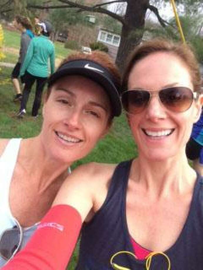 Sisters Leslie Morgan. right, and Kasey Spreyer are getting ready to run their first New York Marathon as part of a team supporting the Sandy Hook Promise advocacy group formed in the wake of the 2012 shootings of 20 first-graders and six educators in Newtown. Photo: Contributed Photo Courtesy Of Kasey Spreyer