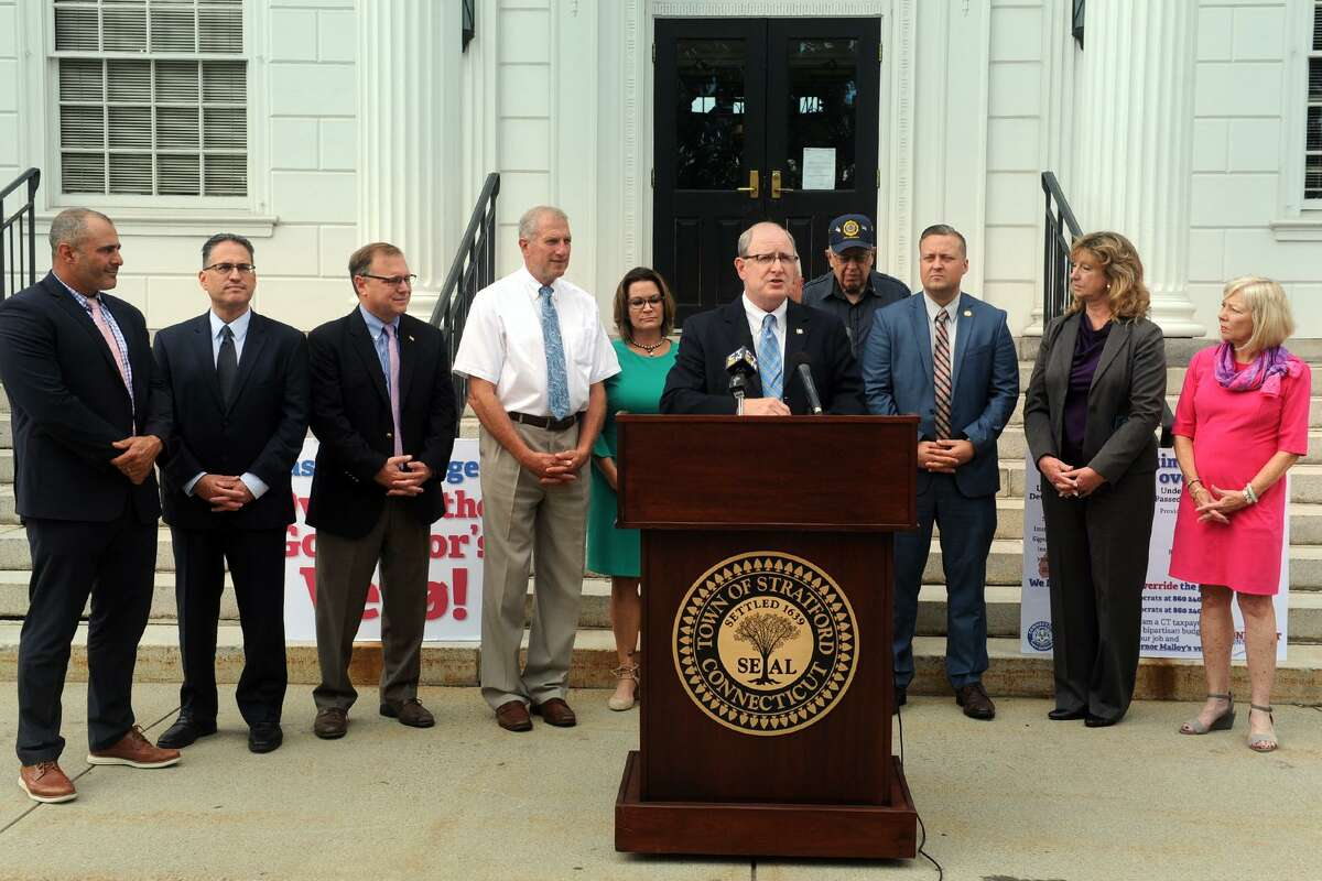 State Sen. Kevin Kelly, of Stratford, is joined by other Republican leaders and lawmakers in front on Stratford Town Hall to call for an override of Gov. Malloy?'s recent veto of the state budget, in Stratford, Conn. Oct. 10, 2017.