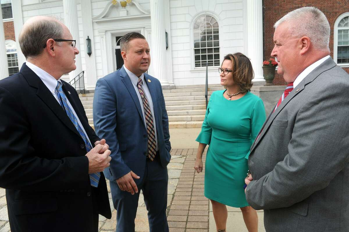 From left, State Sen. Kevin Kelly, of Stratford, State Rep J.P. Sredzinski, of Monoe, State Rep. Nicole Klarides-Ditria, of Seymour, and State Rep. Ben McGorty, of Shelton gather in front on Stratford Town Hall where they called for an override of Gov. Malloy?'s recent veto of the state budget, in Stratford, Conn. Oct. 10, 2017.