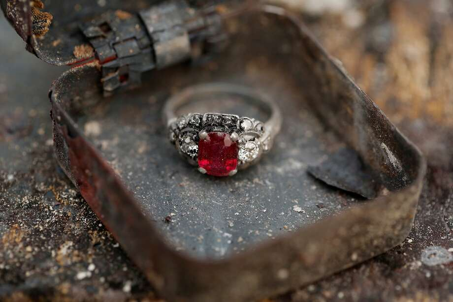 Theres Gilman found her mother-in-law's ruby ring while digging through the rubble of her Santa Rosa home on Tuesday, Oct. 10. As you can see in the photo, it appeared untouched by the flames.  Photo: Guy Wathen, The Chronicle