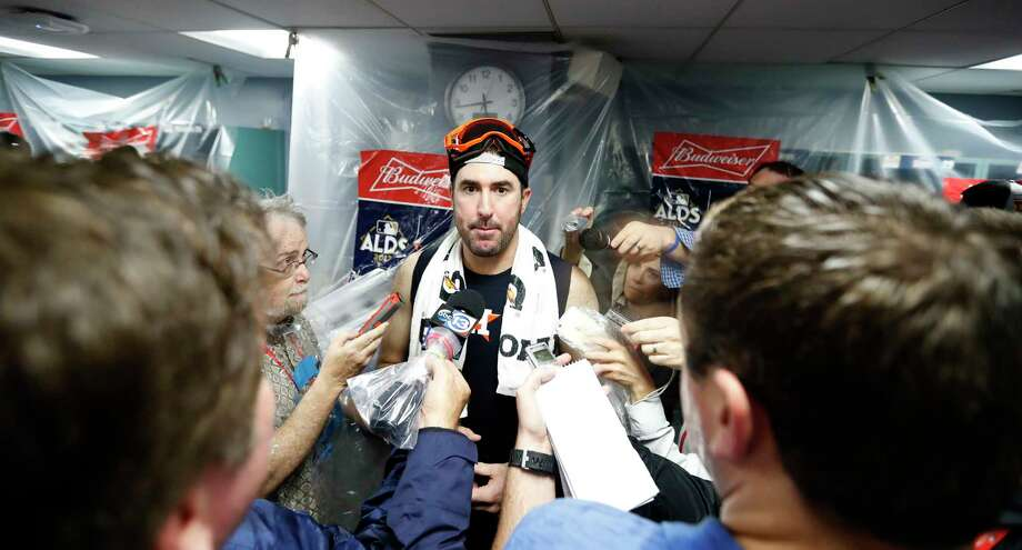 Houston Astros pitcher Justin Verlander is interviewed in the clubhouse after the Astros beat Boston Red Sox 5-4 in the ALDS Game 4 at Fenway Park, Monday, Oct. 9, 2017, in Boston   ( Karen Warren / Houston Chronicle ) Photo: Karen Warren, Staff / @ 2017 Houston Chronicle