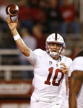 Stanford quarterback Keller Chryst (10) passes the ball during practice before the start of their NCAA college football game against Utah Saturday, Oct. 7, 2017, in Salt Lake City. (AP Photo/Rick Bowmer)