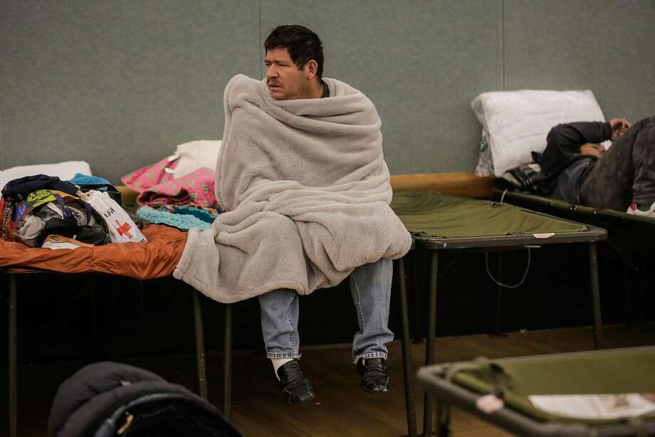 Evacuee Jorge Torres sits on a cot after spending the night at the Petaluma Community Center in Petaluma, Calif., on Tuesday, Oct. 10, 2017. Jorge Torres lost his mobile home in a fire that ravaged areas in Napa, Sonoma and Santa Rosa. Photo: Gabrielle Lurie, The Chronicle