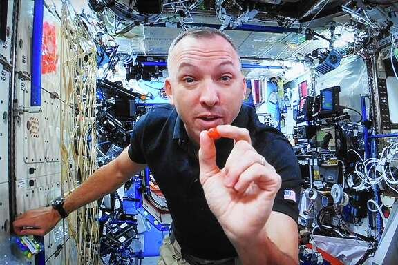 Astronaut Randy Bresnik demonstrates floating around the International Space Station from a live webcast from space.