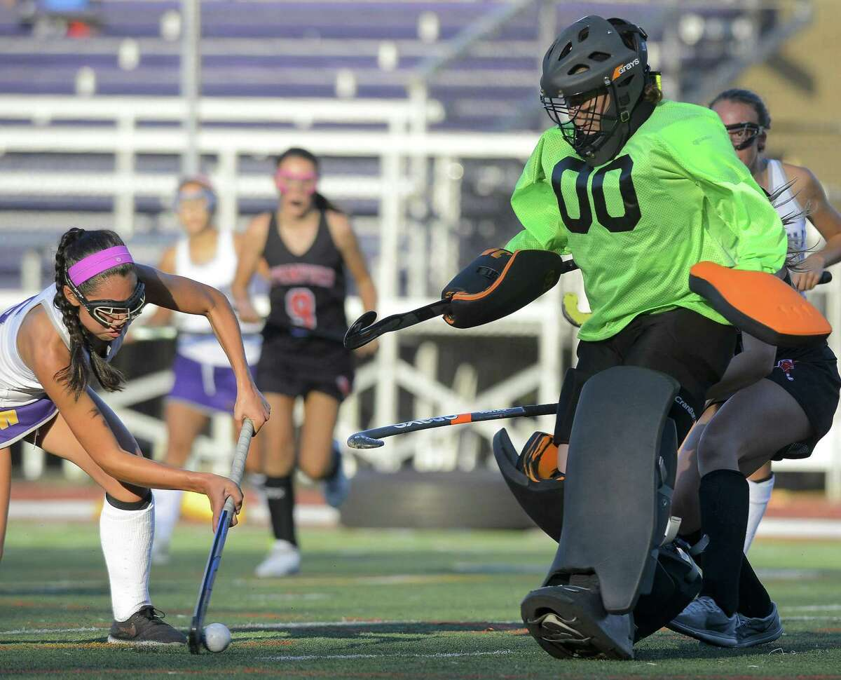 Westhill Anna Martelli (5) puts a shot past Stamford goalie Kristen D'Ariano for a second half score in a FCIAC girls field hockey game at Westhill High School in Stamford, Connecticut on Tuesday, Oct. 10, 2017. Stamford and Westhill played to a 1-1 tie in OT.