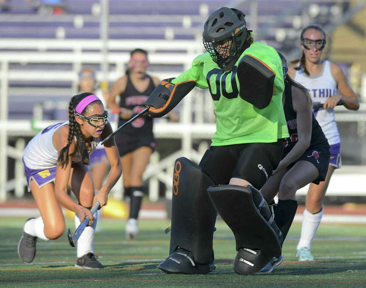 Westhill Anna Martelli (5) follows her shot past Stamford goalie Kristen D'Ariano for a second half score in a FCIAC girls field hockey game at West Hill High School in Stamford, Connecticut on Tuesday, Oct. 10, 2017. Stamford and Westhill played to a 1-1 tie in OT.