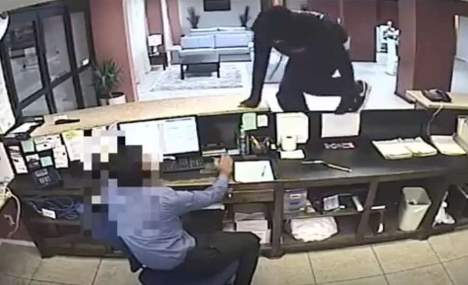 Police are asking for the public's help in finding two men who attacked a worker and robbed a Houston hotel.