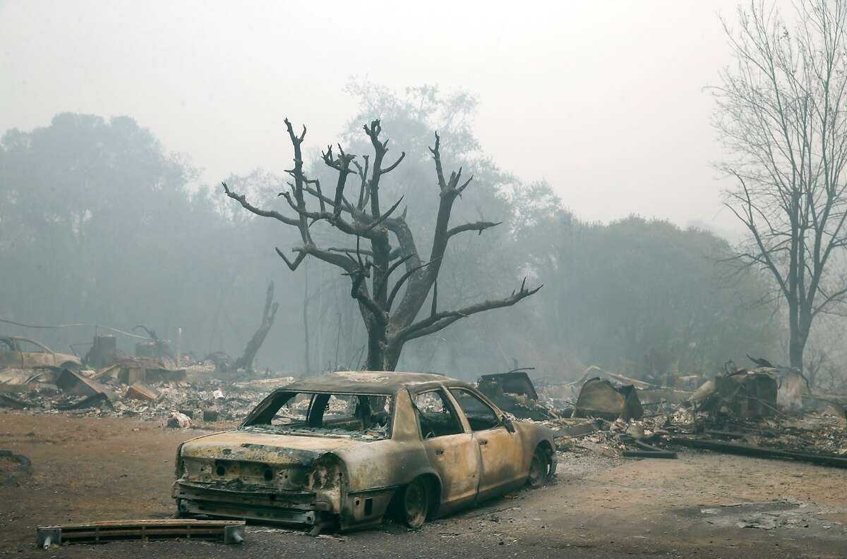 A sedan destroyed by fire remains parked off Tomki Road in Redwood Valley, Calif. on Tuesday Oct. 10, 2017. Authorities have reported at least three people have died and 50 residences have been destroyed by the Redwood Complex Fire.