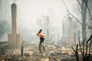 Jeanette Scroggins pauses while searching for signs of her aunt, Karen Aycock, who went missing when the Tubbs fire roared through her Coffey Park neighborhood in Santa Rosa, Calif., on Tuesday, Oct. 10, 2017. Aycock's remains were found in the bathroom of her home.