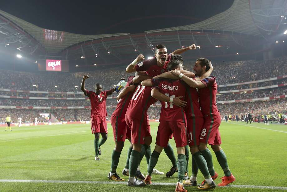 Portugal's Andre Silva celebrates with teammates after scoring against Switzerland in World Cup Group B qualifying match. Photo: Armando Franca, Associated Press