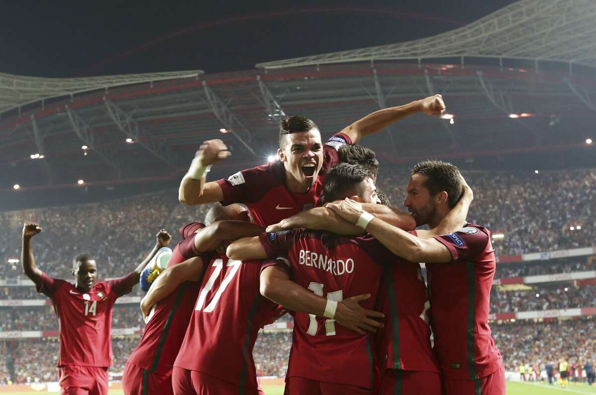 Portugal's Pepe, top, celebrates with his teammates their side's second goal during the World Cup Group B qualifying soccer match between Portugal and Switzerland at the Luz stadium in Lisbon, Tuesday, Oct. 10, 2017. (AP Photo/Armando Franca)