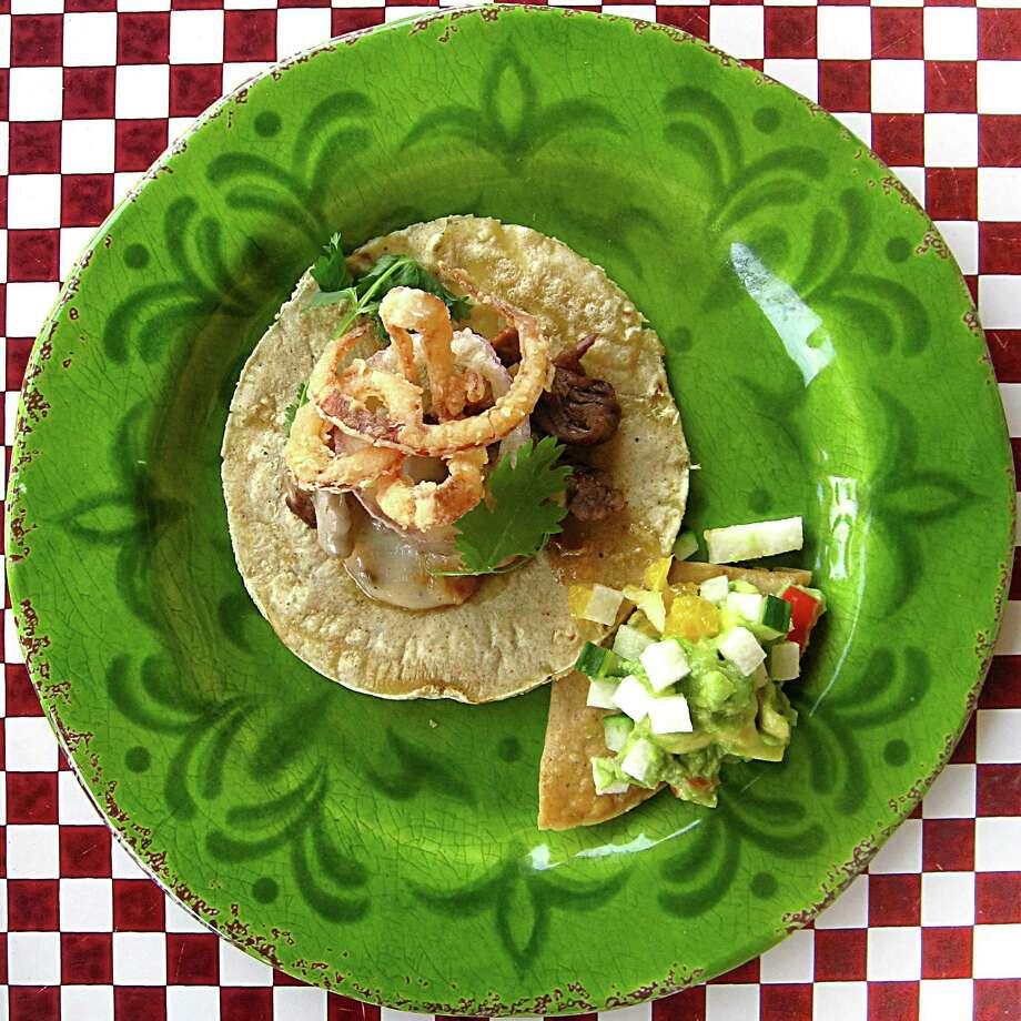 Asada con queso taco on a handmade corn tortilla from The Frutería-Botanero. Photo: Mike Sutter /San Antonio Express-News