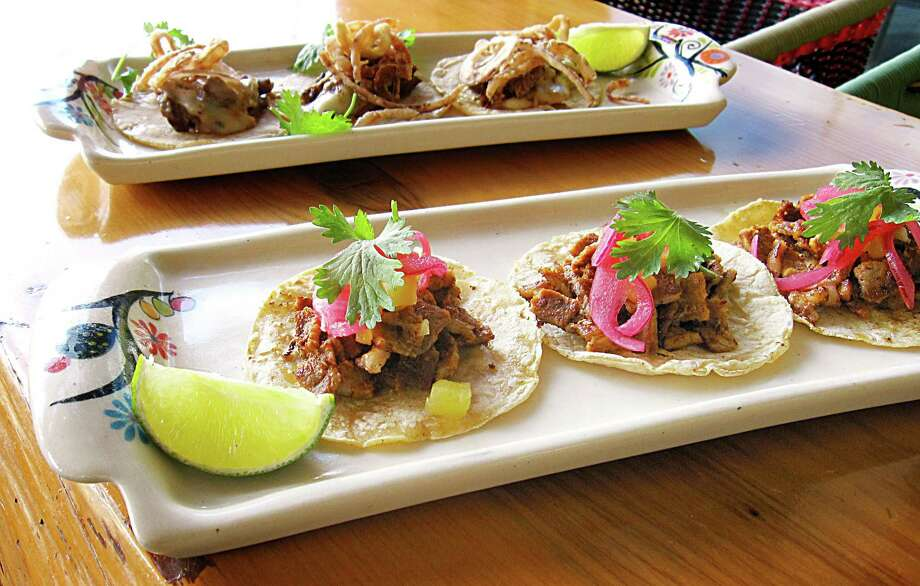 An order of three tacos al pastor on handmade corn tortillas, foreground, and an order of three asada con queso tacos from The Frutería-Botanero. Photo: Mike Sutter /San Antonio Express-News