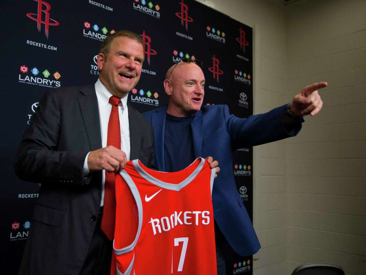 Tilman Fertitta, the new owner of the Houston Rockets, poses for pictures with astronaut Scott Kelly following a press conference at Toyota Center, Tuesday, October 10, 2017. (Mark Mulligan / Houston Chronicle)