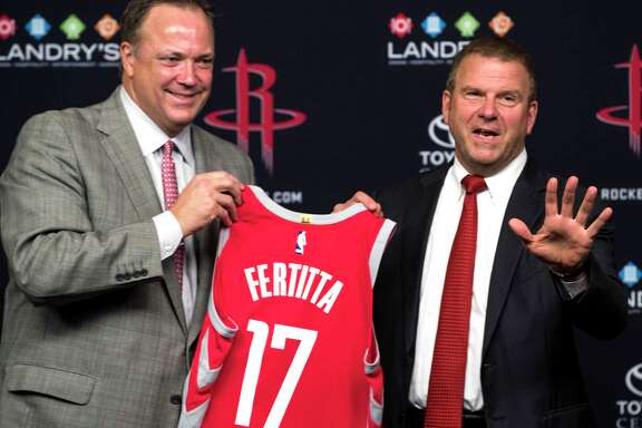 Houston Rockets CEO Tad Brown, left, and new team owner Tilman Fertitta hold up a Rockets jersey during a news conference introducing him as the Rockets new owner at Toyota Center on Tuesday, Oct. 10, 2017, in Houston. ( Brett Coomer / Houston Chronicle )