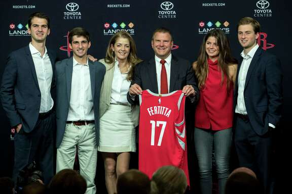 Houston Rockets owner Tilman Fertitta, center, poses for photos with his family, from left, sons, Michael, Blake, wife, Paige, daughter, Blayne and son Patrick during a news conference introducing him as the Rockets new owner at Toyota Center on Tuesday, Oct. 10, 2017, in Houston. ( Brett Coomer / Houston Chronicle )