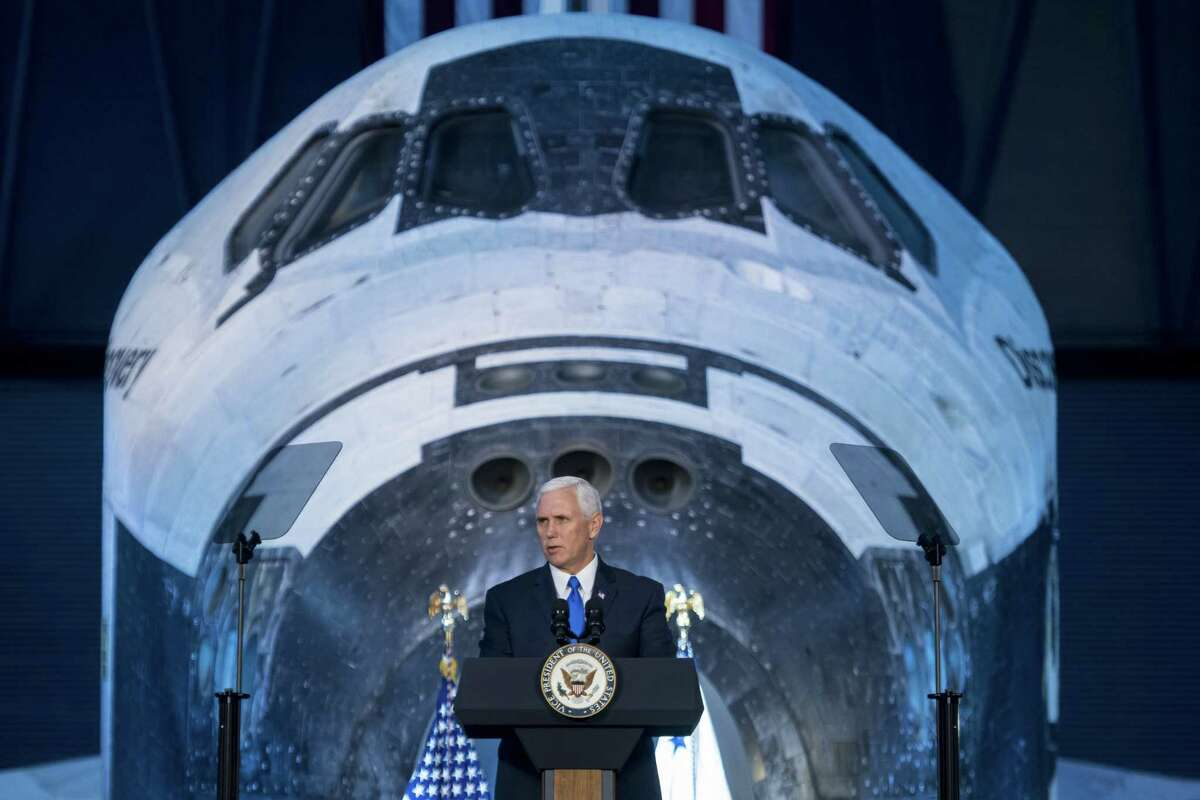 Vice President Mike Pence delivers opening remarks during the National Space Council's first meeting at the Smithsonian National Air and Space Museum's Steven F. Udvar-Hazy Center on Oct. 5. (Photo by Joel Kowsky/NASA via Getty Images)