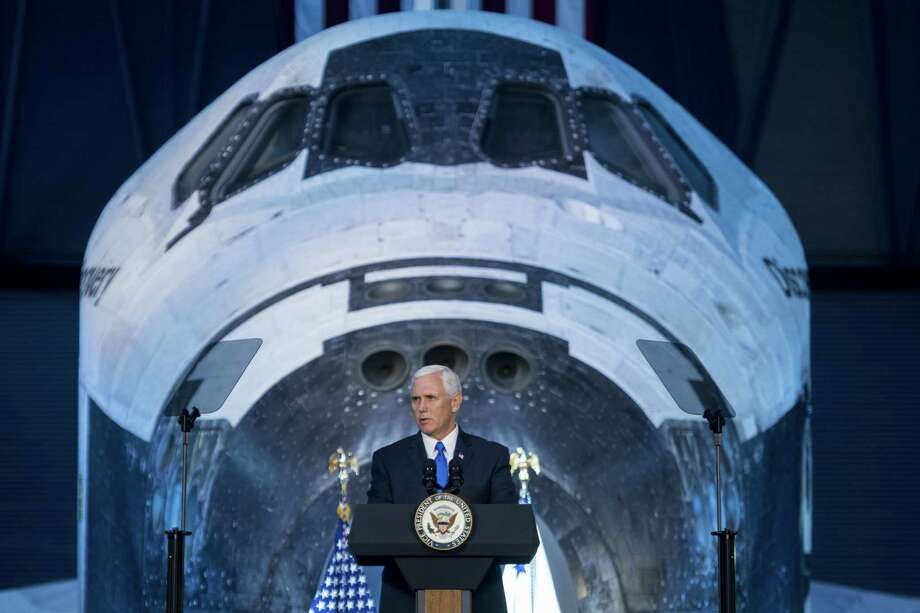 Vice President Mike Pence delivers opening remarks during the National Space Council's first meeting at the Smithsonian National Air and Space Museum's Steven F. Udvar-Hazy Center on Oct. 5. (Photo by Joel Kowsky/NASA via Getty Images) Photo: NASA, Handout / 2017 NASA