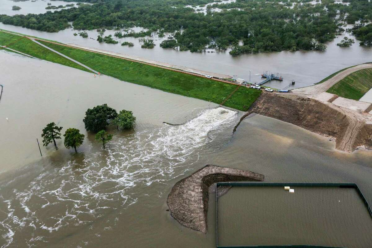 Water is released from the Barker Reservoir in the aftermath of Hurricane Harvey on Tuesday, Aug. 29, 2017, in Houston. ( Brett Coomer / Houston Chronicle )