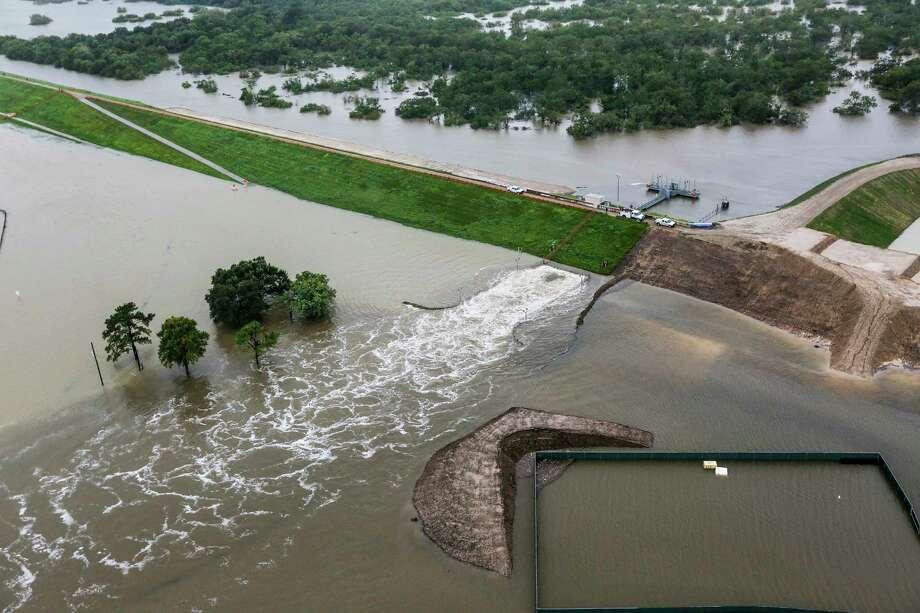 Discussions around improving resilience and adaptation to extreme events often focus on upgrading infrastructure or building new infrastructure, such as bigger levees or flood walls. But cities also need new ways of knowing, evaluating and anticipating risk by updating their information systems. In this photo: Stormwater is released from Addicks dam. Photo: Brett Coomer, Staff / © 2017 Houston Chronicle