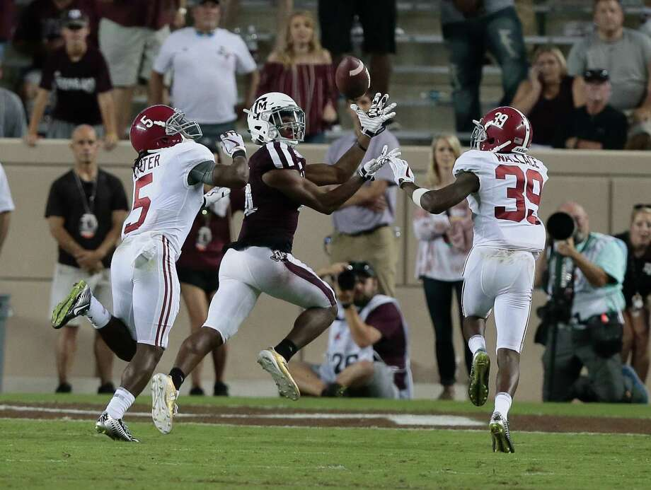 A&M's Damion Ratley makes a 32-yard catch against Alabama last week. Photo: Bob Levey, Stringer / 2017 Getty Images