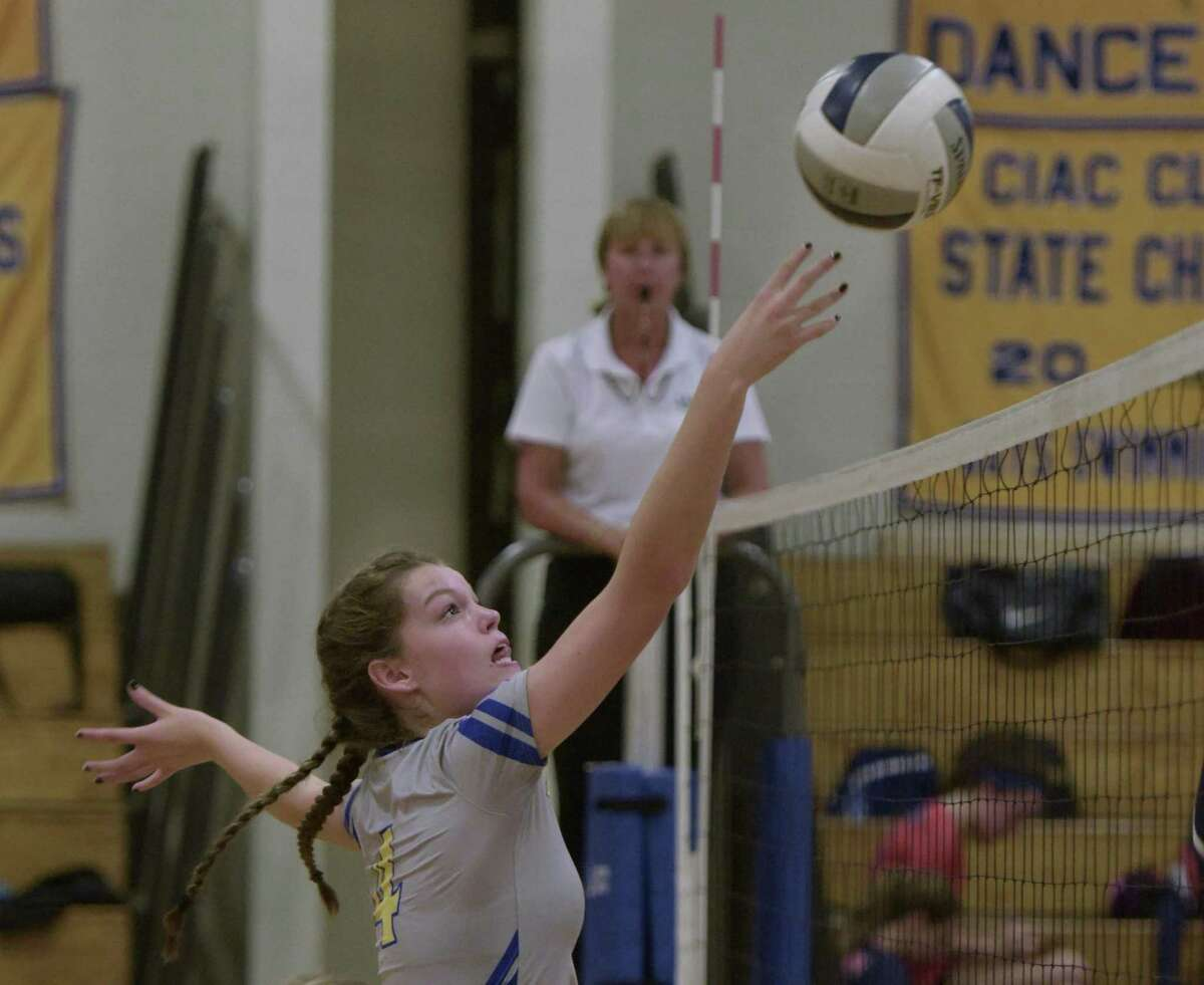 Brookfield's Holly Fleming (4) tips the ball over the net in the girls volleyball match between Danbury and Brookfield high schools, Tuesday afternoon, October 10, 2017, at Brookfield High School, in Brookfield, Conn.