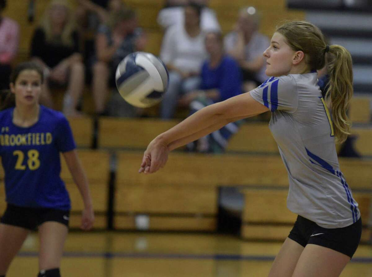 Brookfield's Erica Morey (16) bumps the ball in the girls volleyball match between Danbury and Brookfield high schools, Tuesday afternoon, October 10, 2017, at Brookfield High School, in Brookfield, Conn.