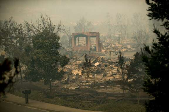 A wall stands at a home destroyed by the Tubbs fire in the Fountaingrove area of Santa Rosa, Calif., on Tuesday, Oct. 10, 2017.