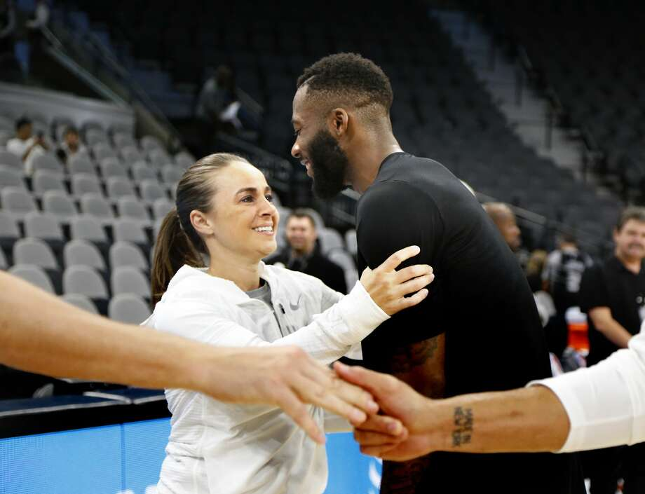 SAN ANTONIO,TX - OCTOBER 10:  Jonathon Simmons #17 of the Orlando Magic greets San Antonio assistant coach Becky Hammon before the start of their game at AT&T Center on October 10, 2017 in San Antonio, Texas.  NOTE TO USER: User expressly acknowledges and agrees that , by downloading and or using this photograph, User is consenting to the terms and conditions of the Getty Images License Agreement. (Photo by Ronald Cortes/Getty Images) Photo: Ronald Cortes/Getty Images
