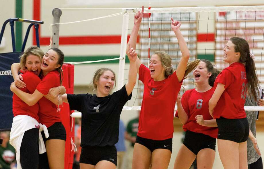 Oak Ridge players celebrate after defeating The Woodlands 15-8 in the fifth and final set of a District 12-6A high school volleyball match at The Woodlands High School, Tuesday, Oct. 10, 2017, in The Woodlands. Photo: Jason Fochtman, Staff Photographer / © 2017 Houston Chronicle