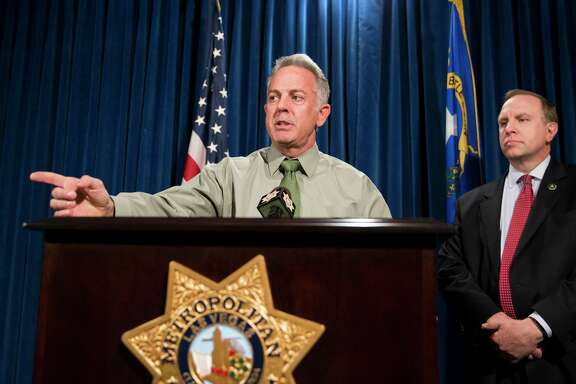 Clark County Sheriff Joe Lombardo, left, dismissed conspiracy theories about the changing timeline of Las Vegas' mass shooting.