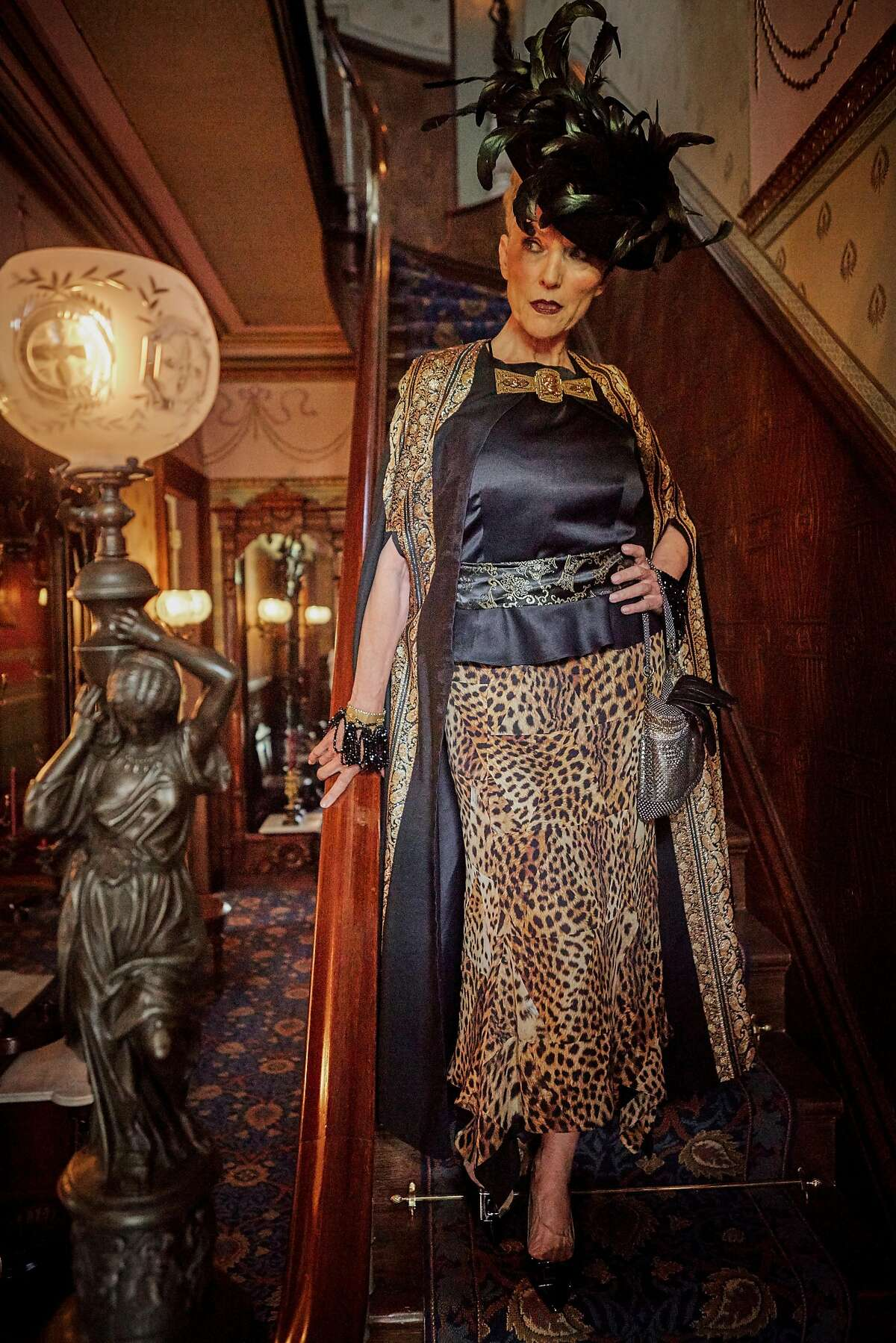 Maye wears a Juan Carlos leopard gown, $1,995, Barneys New York; Edwardian fabric cape, $595, gold fringe sash, $75, and Edwardian picture hat, $295, all Decades of Fashion; Laura B chain-mail purse, $1,345, Betty Lin, 3625 Sacramento St.; William de Lillo beaded bracelets, $6,500, MDVII Antiques; Ralph by Ralph Lauren patent pump, $98, Macy�s Union Square. Photography: Russell Yip ; Design Director: Elizabeth Burr; Style Editor: Laura Compton; Deputy Style Editor: Angela Salazar; Stylist: Tony Bravo; Makeup: Victor Cembellin / MAC Cosmetics; Hair: Dwight Davis / davissaizsalon.com; Models: Maye Musk / Look Model Agency, SF; Audrey B. / Look Model Agency, SF; Stylist Asst: Rachel Znerold; Photo Assistants.: Stan Pechner, Cameron Robert, Danielle Mitchell; Hair Assistant: Norma Avalos