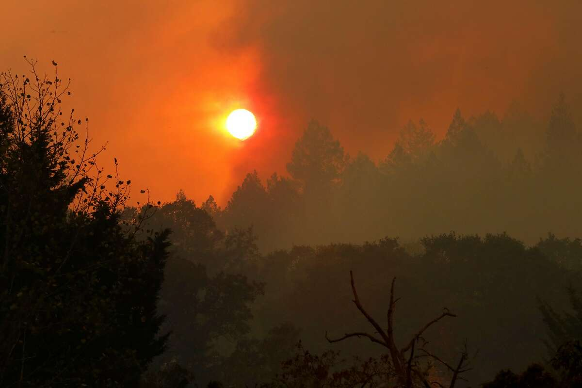 Smoke covers the sun in the Oakmont neighborhood in Santa Rosa, Ca. on Tuesday October 10, 2017. Massive wildfires ripped through Napa and Sonoma counties, destroying hundreds of homes and businesses on Monday morning.