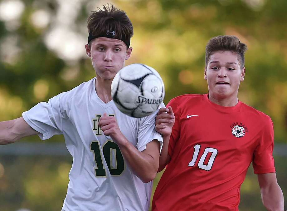 Notre Dame senior forward Bradley Doyle battles Cheshire junior midfielder Matthew Mayano Tuesday. Cheshire won 2-1. Photo: Catherine Avalone / Hearst Connecticut Media / New Haven Register