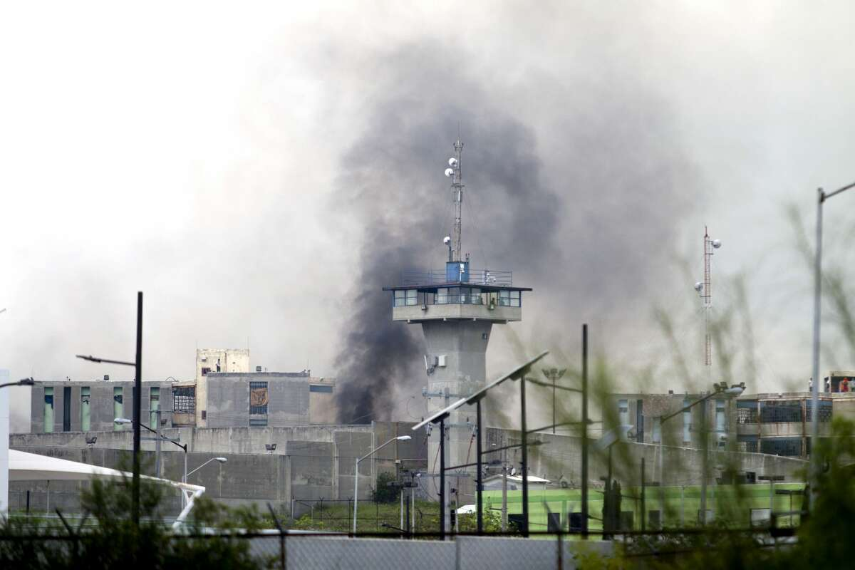 Smoke rises from the Cadereyta prison where a brawl among the prisoners left several wounded on October 10, 2017 in Cadereyta, Nuevo Leon, Mexico. / AFP PHOTO / Julio Cesar AGUILAR (Photo credit should read JULIO CESAR AGUILAR/AFP/Getty Images)