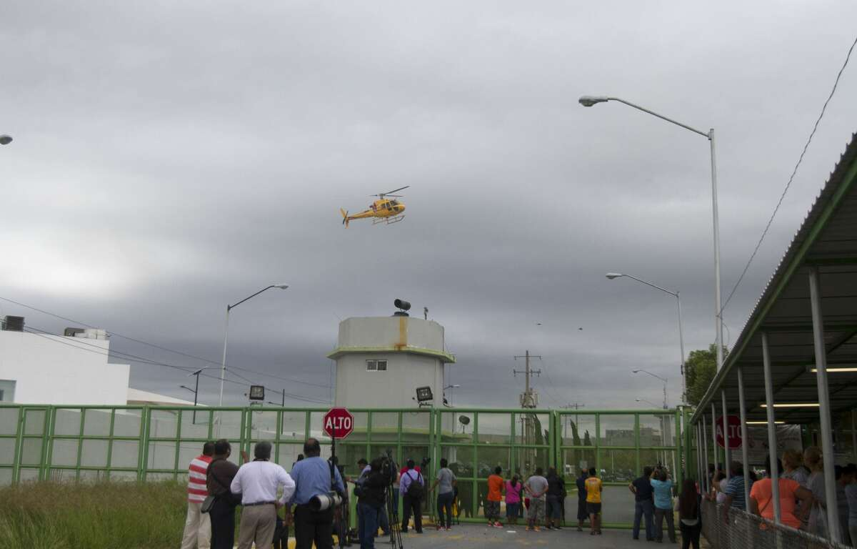 A helicopter overflies the Cadereyta prison where a brawl among the prisoners left several wounded on October 10, 2017 in Cadereyta, Nuevo Leon, Mexico. / AFP PHOTO / Julio Cesar AGUILAR (Photo credit should read JULIO CESAR AGUILAR/AFP/Getty Images)