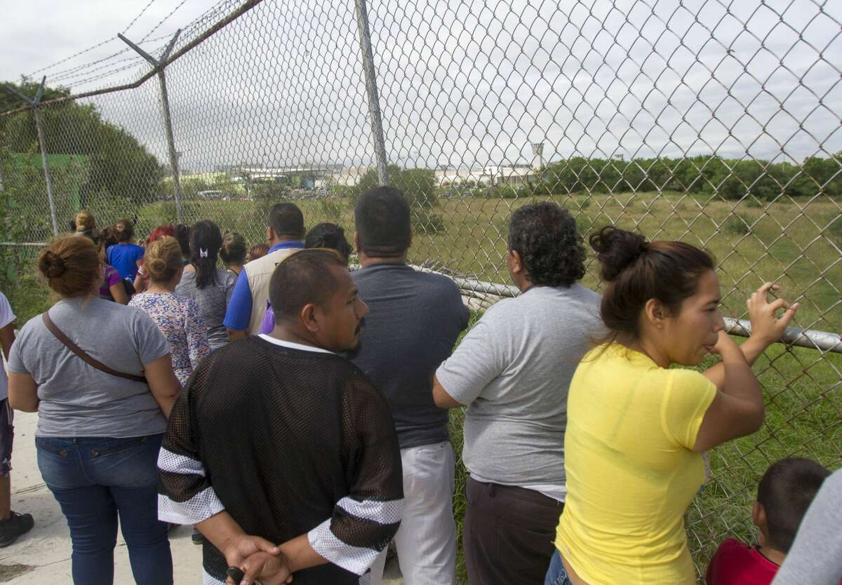 Relatives of inmates wait outside the Cadereyta prison where a brawl among the prisoners left several wounded on October 10, 2017 in Cadereyta, Nuevo Leon, Mexico. / AFP PHOTO / Julio Cesar AGUILAR (Photo credit should read JULIO CESAR AGUILAR/AFP/Getty Images)
