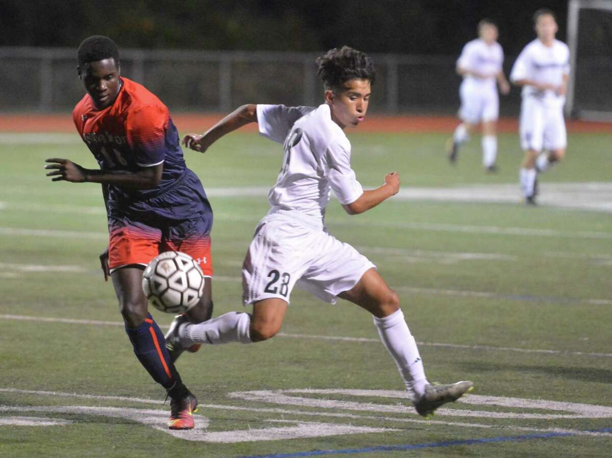 McMahon's Duly Bolivar gets the ball away from Norwalk's Will Gaviria during Tuesday's game.