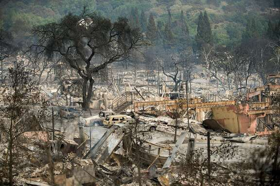 Following the Tubbs fire, leveled buildings line the Fountaingrove Village development Santa Rosa, Calif., on Tuesday, Oct. 10, 2017.