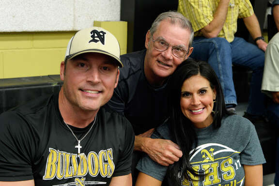"""Jonathan Miguez, """"Papa"""" Pepper Gross and Reni Miguez at the volleyball game between Nederland and Port Neches-Groves on Tuesday evening.  Photo taken Tuesday 10/10/17 Ryan Pelham/The Enterprise"""