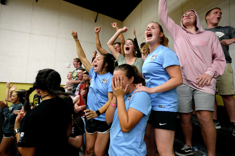 Nederland students cheer after the Bulldogs won a set against Port Neches-Groves in a volleyball game on Tuesday evening.  Photo taken Tuesday 10/10/17 Ryan Pelham/The Enterprise Photo: Ryan Pelham / ©2017 The Beaumont Enterprise/Ryan Pelham