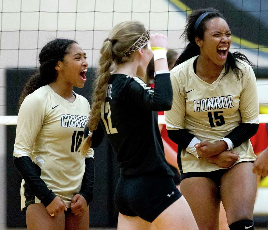 Conroe's Victoria Ratcliff (15) celebrates after scoring a point with Sydney Walling (12) and Jazzmin Kim (10) during the first set of a District 12-6A volleyball match at Conroe High School, Tuesday, Sept. 19, 2017, in Conroe. Photo: Jason Fochtman, Staff Photographer / © 2017 Houston Chronicle