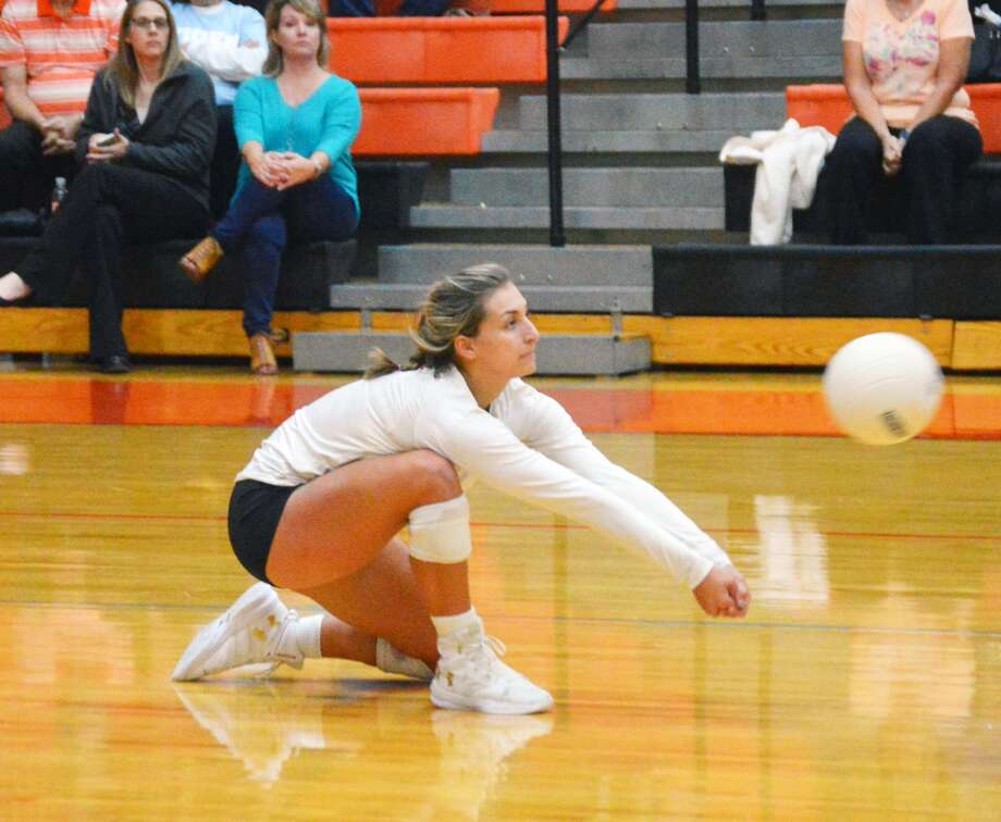 Edwardsville senior Megan Woll makes a dig late in the first game against Villa Duchesne inside Lucco-Jackson Gymnasium.