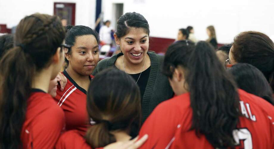 Minutemen coach Samantha Mendez enjoys the victory as Memorial beats Brackenridge in volleyball at the Edgewood Gym on October 10, 2017. Photo: Tom Reel /San Antonio Express-News / 2017 SAN ANTONIO EXPRESS-NEWS