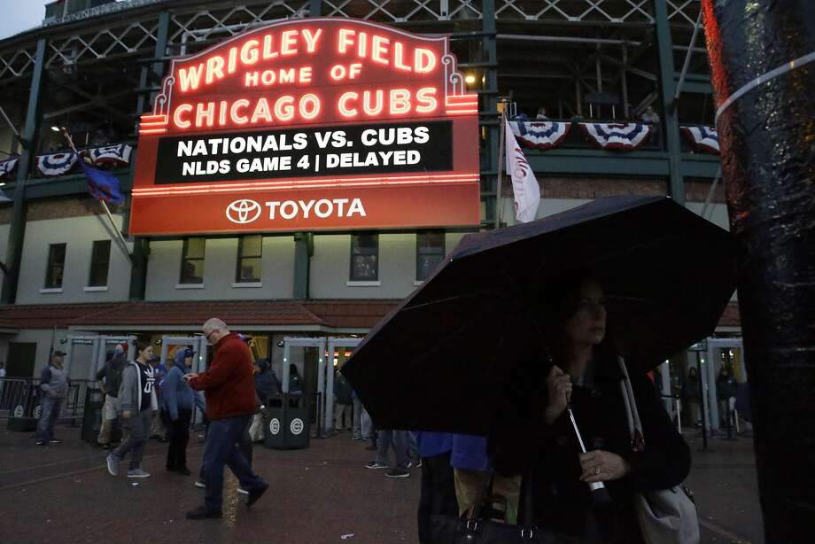 The scene Tuesday at Wrigley Field was subdued as rain postponed Game 4 of the NL Division Series between the Cubs and Nationals. Rain also is in the forecast for Wednesday. Photo: Nam Y. Huh, Associated Press