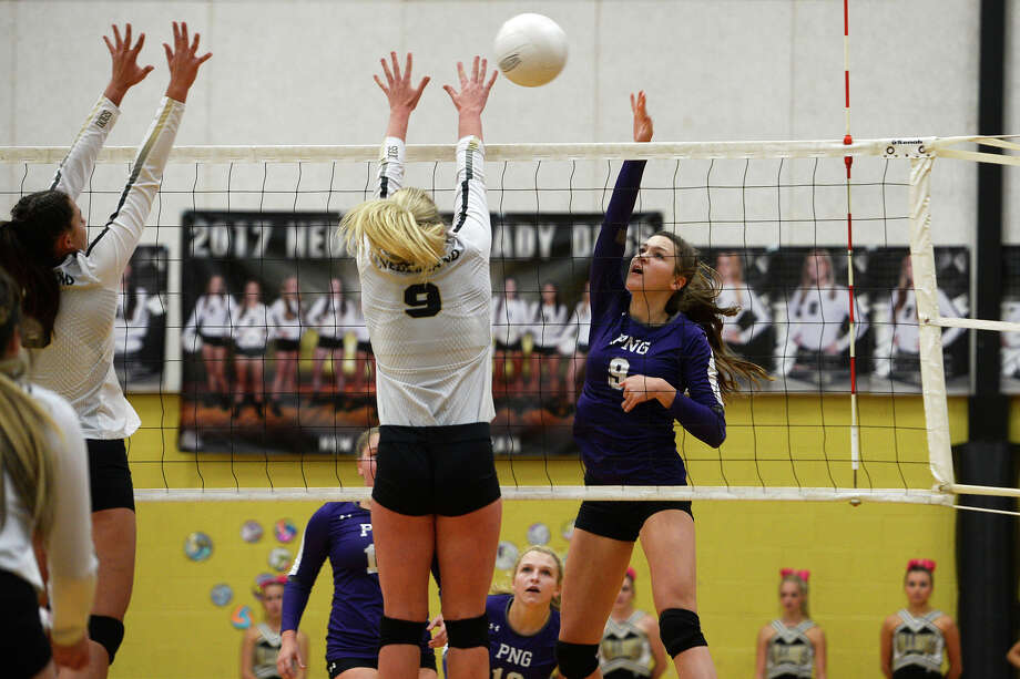 Nederland's Abbey Montalvo attempts to block a shot by Port Neches-Groves' Layla Stansbury in a volleyball game on Tuesday evening.  Photo taken Tuesday 10/10/17 Ryan Pelham/The Enterprise Photo: Ryan Pelham / ©2017 The Beaumont Enterprise/Ryan Pelham
