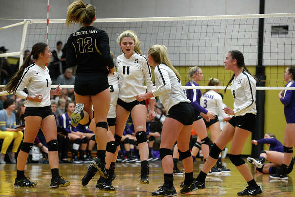 Nederland players celebrate a point against Port Neches-Groves in a volleyball game on Tuesday evening. Photo taken Tuesday 10/10/17 Ryan Pelham/The Enterprise