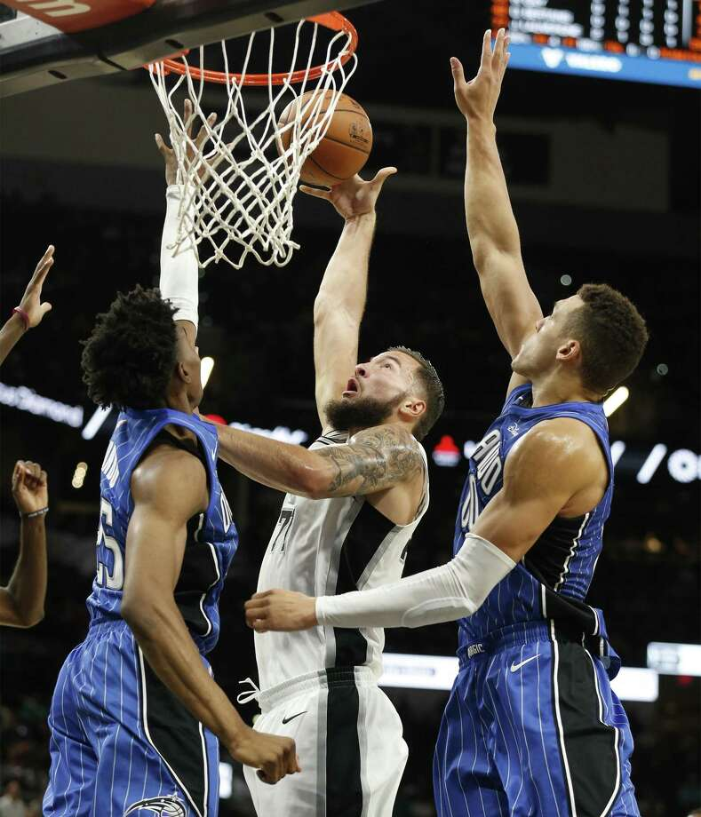Spurs' Joffrey Lauvergne (77) goes up for a shot against Orlando Magic's Wes Iwundu (25) and Aaron Gordon (00) during their pre-season game at the AT&T Center on Tuesday, Oct. 10, 2017. (Kin Man Hui/San Antonio Express-News) Photo: Kin Man Hui, Staff / San Antonio Express-News / ©2017 San Antonio Express-News