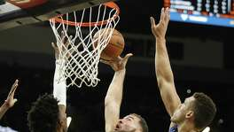Spurs' Joffrey Lauvergne (77) goes up for a shot against Orlando Magic's Wes Iwundu (25) and Aaron Gordon (00) during their pre-season game at the AT&T Center on Tuesday, Oct. 10, 2017. (Kin Man Hui/San Antonio Express-News)