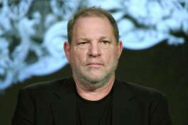 """FILE - In this Jan. 6, 2016 file photo, producer Harvey Weinstein participates in the """"War and Peace"""" panel at the A&E 2016 Winter TCA in Pasadena, Calif. Weinstein has been fired from The Weinstein Co., effective immediately, following new information revealed regarding his conduct, the company's board of directors announced Sunday, Oct. 8, 2017. (Photo by Richard Shotwell/Invision/AP, File) ORG XMIT: LA707"""